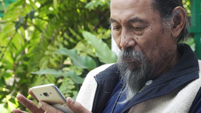 senior people using smartphone - handsome people stock videos & royalty-free footage