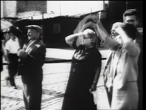 vídeos de stock e filmes b-roll de senior people waving handkerchiefs at evacuees / beginning of berlin wall / newsreel - 1961