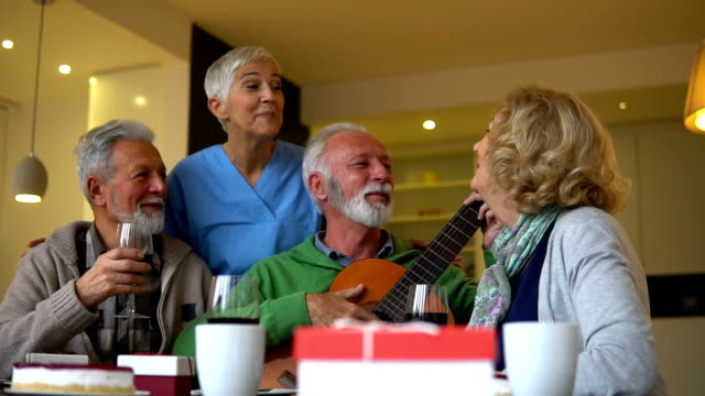 senior people with acoustic guitar - sheltered housing stock videos & royalty-free footage