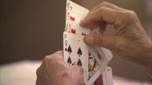 cu senior person playing cards, beijing, china - カードゲーム点の映像素材/bロール