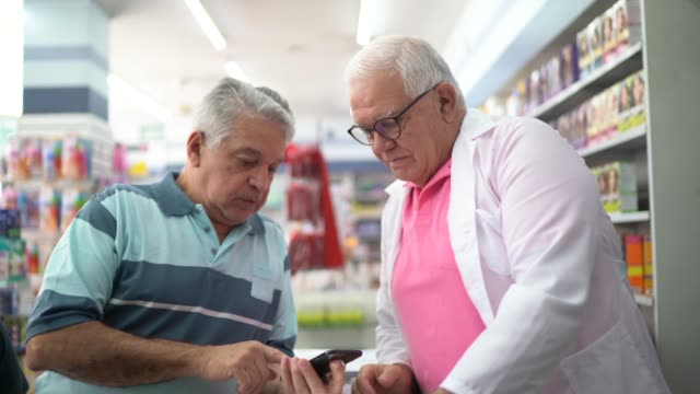 senior pharmacist supporting a customer - prescription stock videos & royalty-free footage