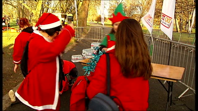 senior politicians speak out against proposed mps pay rise england london ext various of people sat outside pub dressed as father christmas people... - chancellor stock videos & royalty-free footage