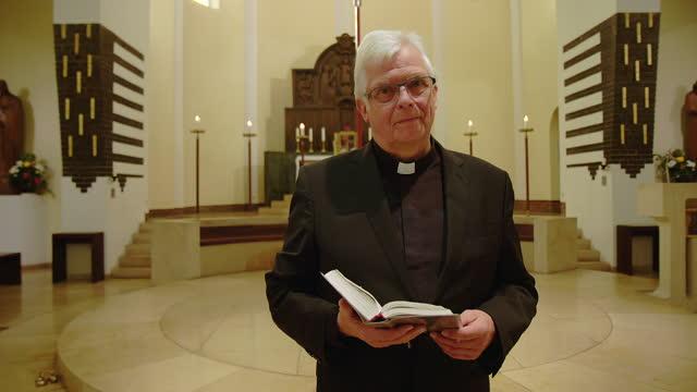 senior priest giving online sermon during lockdown - priest stock videos & royalty-free footage