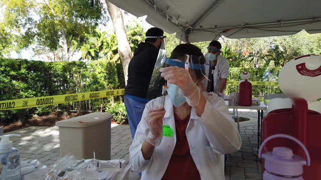 senior residents of the palace nursing and rehabilitation center receive the first dose of pfizer-biontech vaccine in miami, florida, u.s., on... - dose stock videos & royalty-free footage