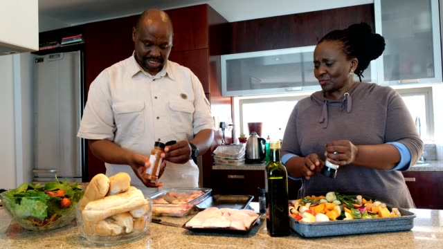 senior retired couple preparring a family meal - african american ethnicity stock videos & royalty-free footage