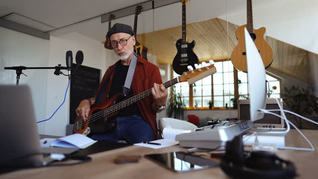 senior rock guitarist playing guitar in his home studio - rock musician stock videos & royalty-free footage