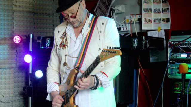 senior rock musician playing electric guitar - cool attitude stock videos & royalty-free footage