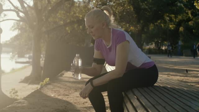 Senior runner drinking water (slow motion)