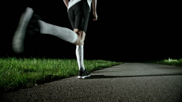 SLO MO PAN Senior runner running at night