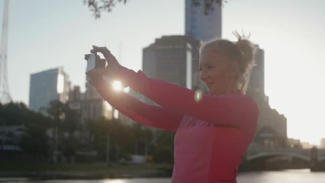 senior runner taking selfie - leisure activity stock videos & royalty-free footage