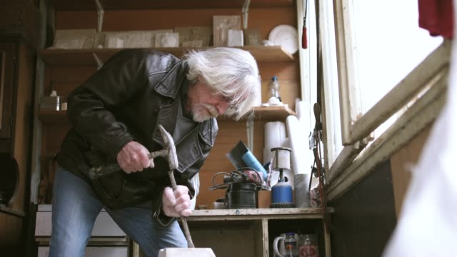 senior sculptor working at his garage - sculpture stock videos and b-roll footage