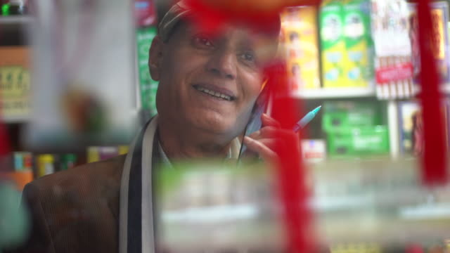 stockvideo's en b-roll-footage met a senior shop keeper. - werkende bejaarden
