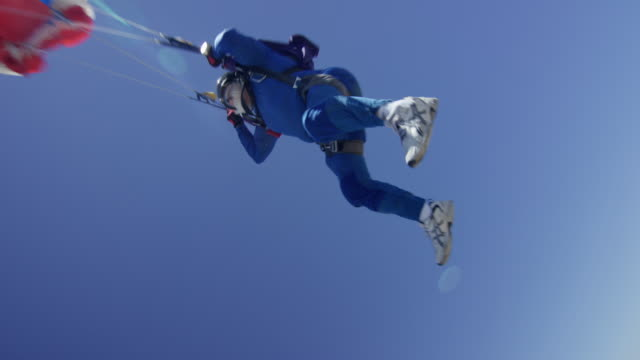 senior skydiver deploys his parachute - free falling stock videos & royalty-free footage