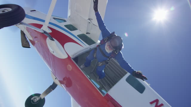 senior skydiver exits airplane - parachute stock videos & royalty-free footage