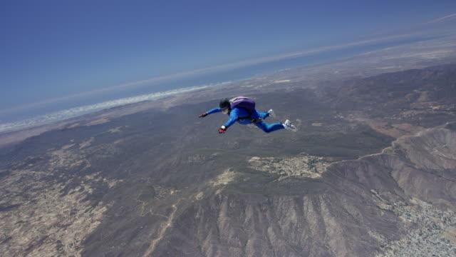 Senior Skydiver Falls Through An Open Sky