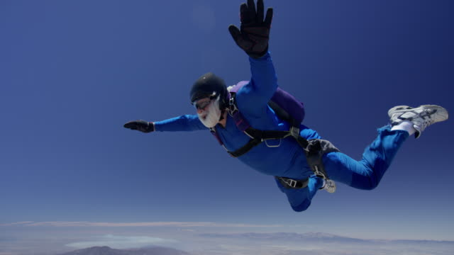Senior Skydiver On A Crystal Clear Day