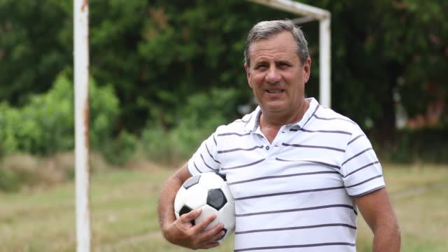 Senior Fußballspieler und-Trainer
