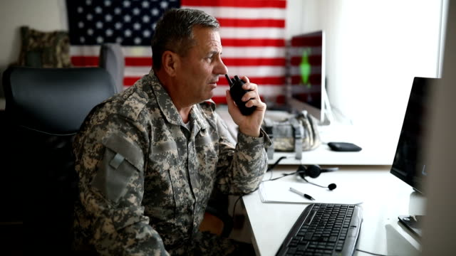 us senior soldier talking on walkie-talkie - us military stock videos & royalty-free footage
