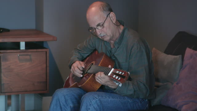senior southern european man plays guitar - southern european stock videos & royalty-free footage