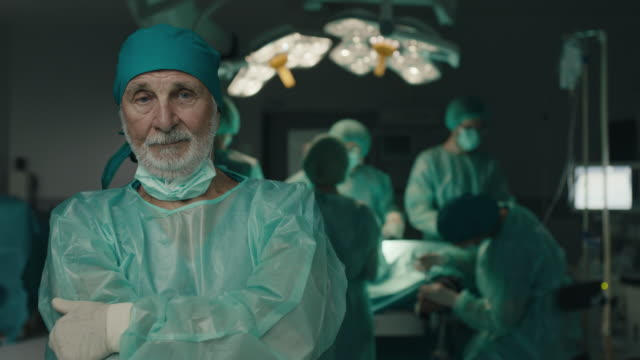 senior surgeon feeling sad at operating room - surgeon stock videos & royalty-free footage