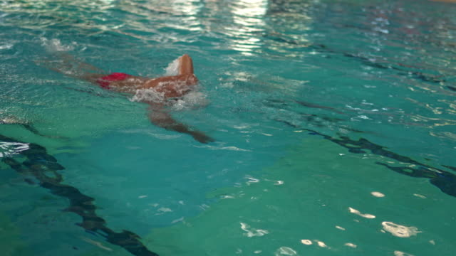 senior swimmer working out in the pool - human limb stock videos & royalty-free footage