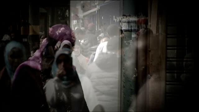 senior teacher involved in alleged muslim 'takeover' of schools in birmingham speaks out people along street including women wearing headscarves... - 女性教師点の映像素材/bロール