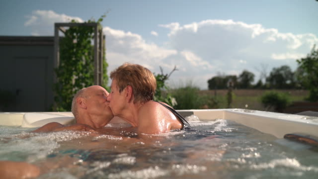 Senior Tenderness, senior couple kissing in hot tub