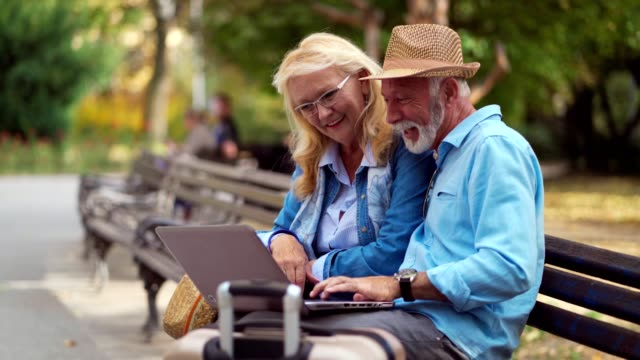 senior tourists making video call in park - baby boomer stock videos & royalty-free footage