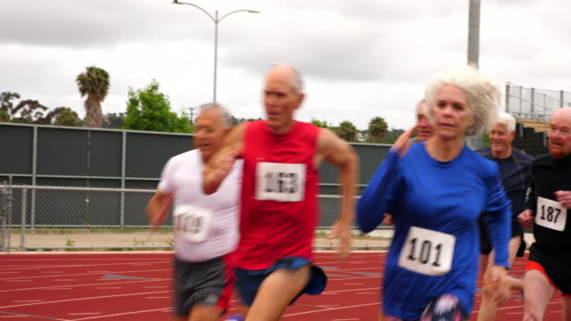 ms senior track athletes running distance race on track - active seniors stock videos & royalty-free footage