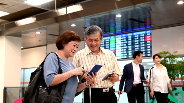 senior travelers at an arrivals gate - ethnicity stock videos & royalty-free footage
