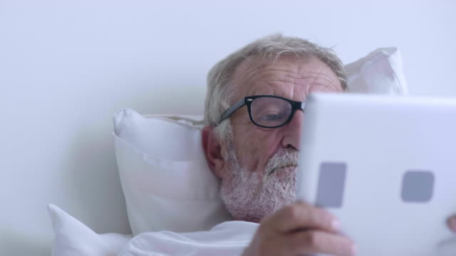 senior using tablet - the ageing process stock videos & royalty-free footage