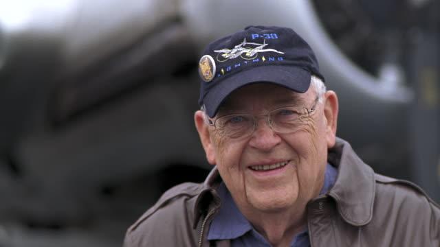 cu pan senior veteran smiling near b-17 flying fortress propeller airplane / seattle, washington, usa - war veteran stock videos & royalty-free footage