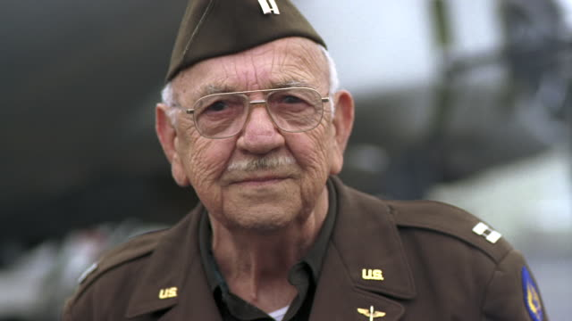 cu senior veteran wearing military uniform and standing near b-17 flying fortress airplane / seattle, washington, usa - veteran stock-videos und b-roll-filmmaterial
