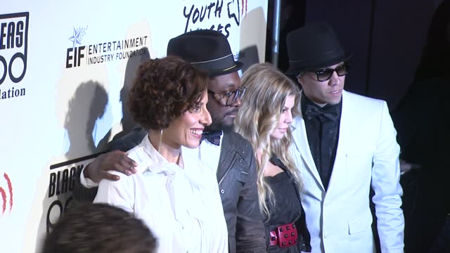 Senior vice president of Adobe Systems Incorporated Ann Lewnes singers William Fergie and Taboo of the Black Eyed Peas at the 5th Annual Black Eyed...