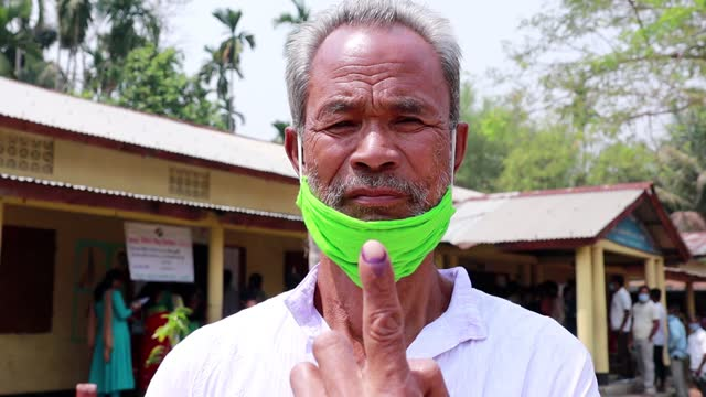 senior voter shows his ink mark on finger after cast her vote on the third phase of the assam assembly election, at a polling station in kamrup... - senior men stock videos & royalty-free footage