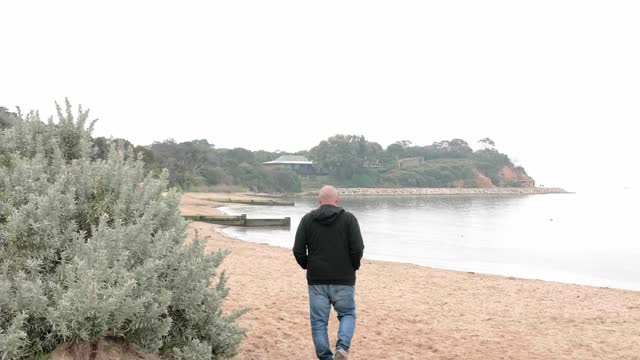 senior walking on beach - leisure activity stock videos & royalty-free footage