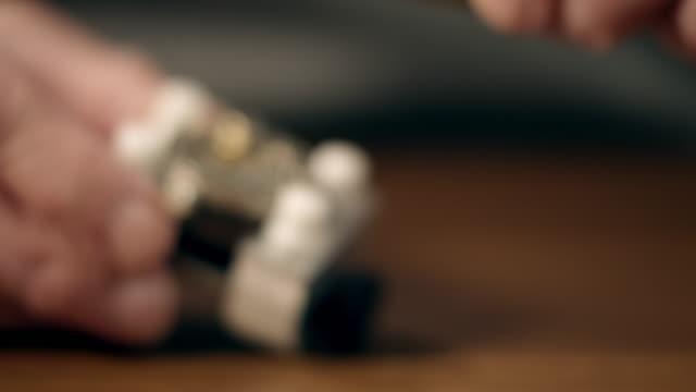 senior watchmaker assembling watch - rack focus stock videos & royalty-free footage
