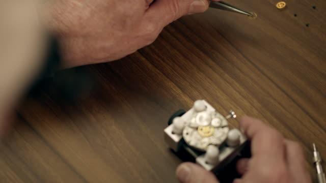 senior watchmaker assembling watch - wood grain stock videos & royalty-free footage