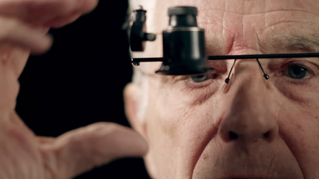 senior watchmaker assembling watch - part of stock videos & royalty-free footage