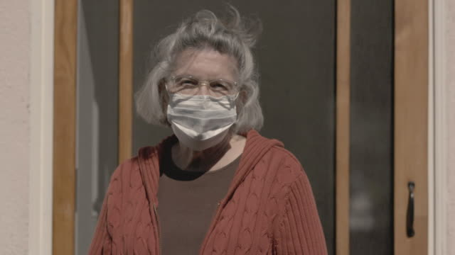 senior with mask covid-19 protection - protective face mask stock videos & royalty-free footage