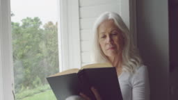Senior woman alone at home