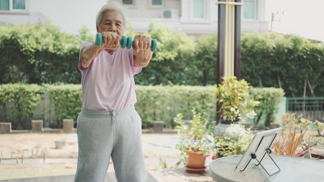 senior woman and dumbbell - health technology stock videos & royalty-free footage