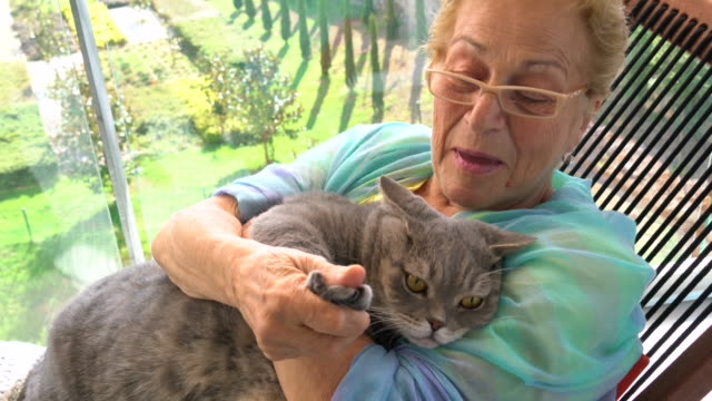 senior woman and her cat