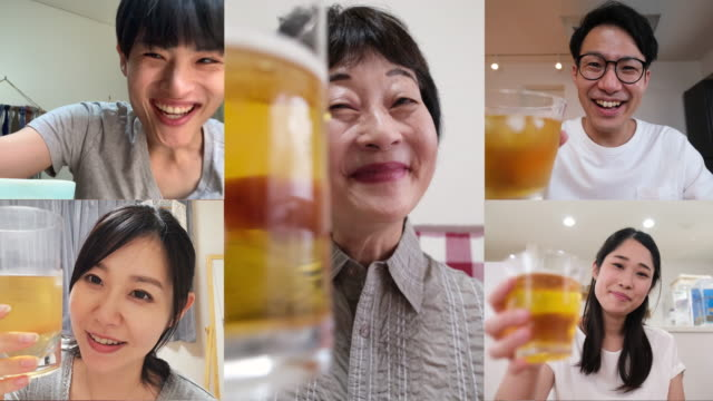 senior woman and her younger friends talking on virtual happy hour - happy hour stock videos & royalty-free footage