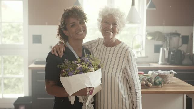 senior woman arm around smiling female nurse - dedication stock videos & royalty-free footage