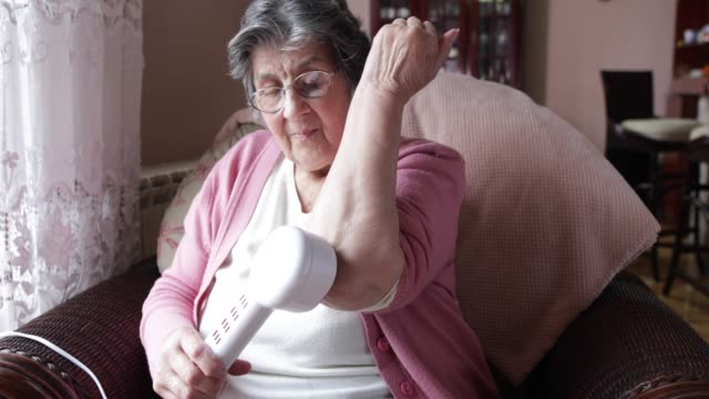 senior woman at home - massager stock videos and b-roll footage