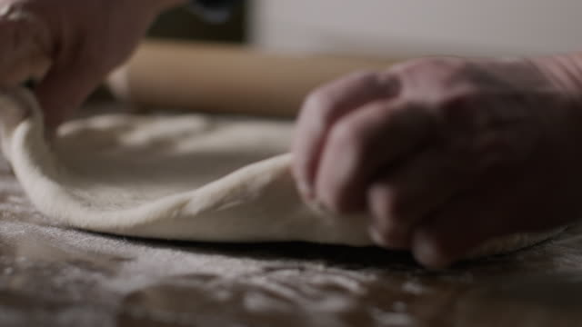 senior woman baking . the process of making pie dough by hand stock video - apron stock videos & royalty-free footage