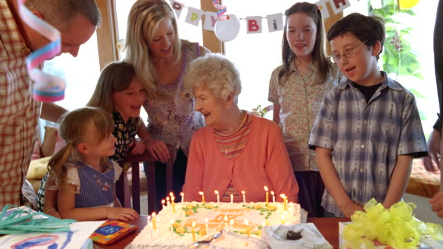 ms senior woman blowing out candles on birthday cake with her family / washington state, usa - over 80 stock videos & royalty-free footage