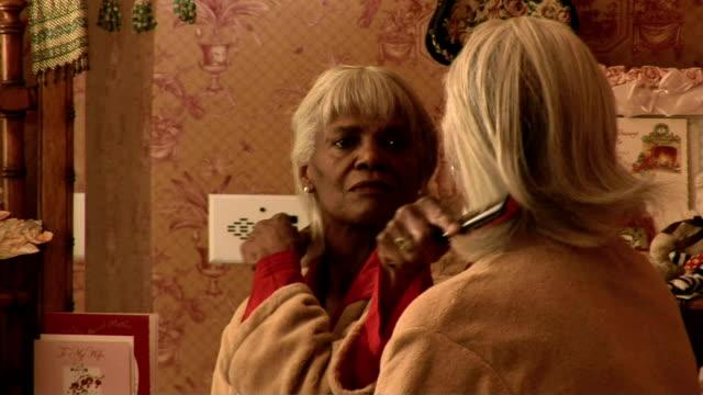 senior woman brushing hair - brushing hair stock videos & royalty-free footage