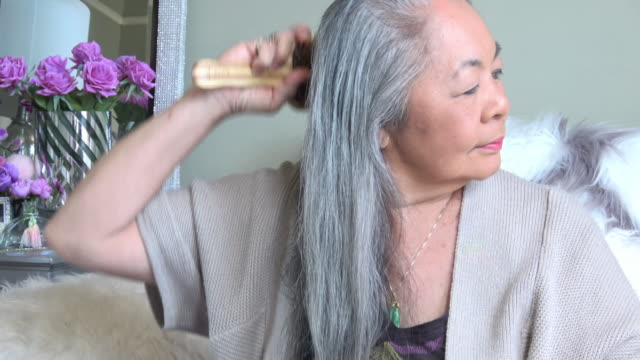 senior woman brushing her long hair - brushing hair stock videos & royalty-free footage